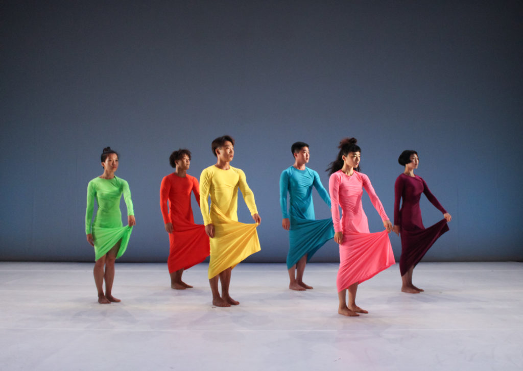 6 dancers in colourful dresses