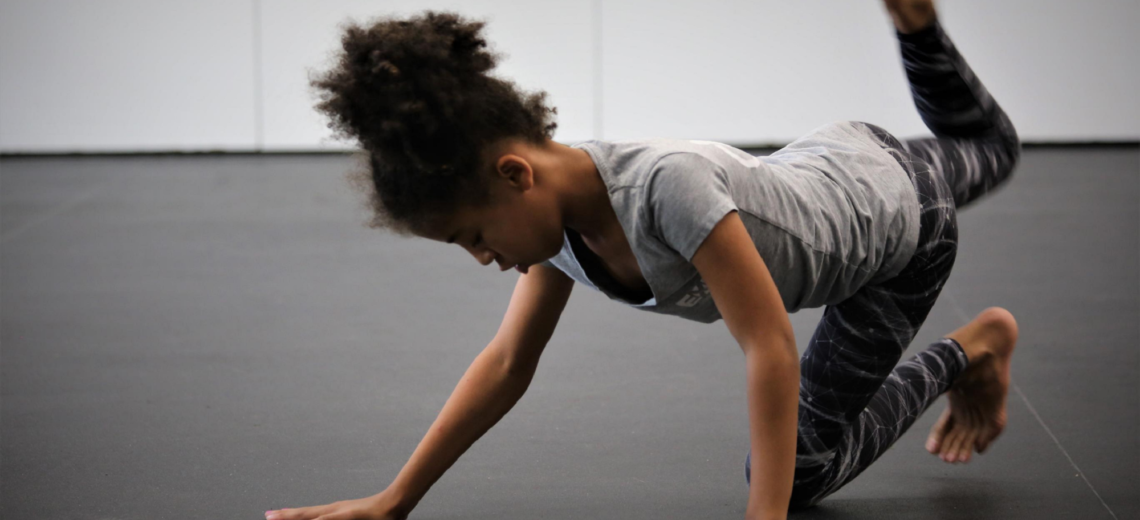 Youth dancer in position on floor