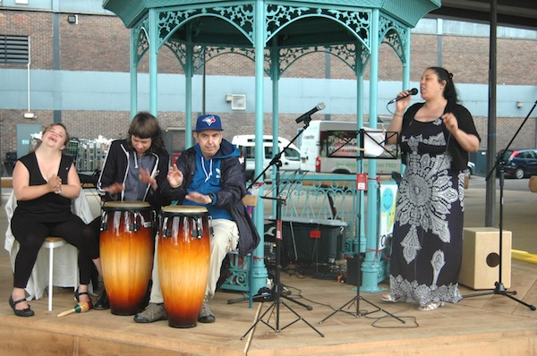 4 musicians on a band stand