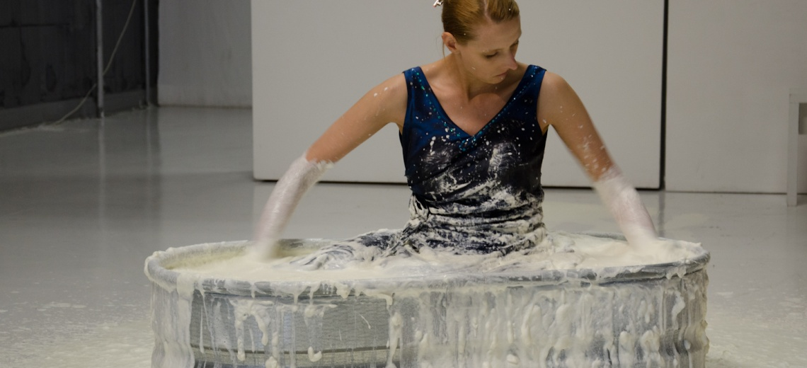 Woman in vat of white liquid