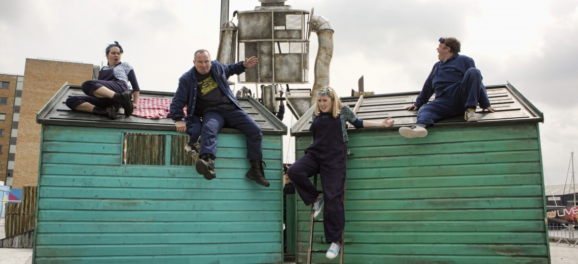 Four actors on shed roofs.