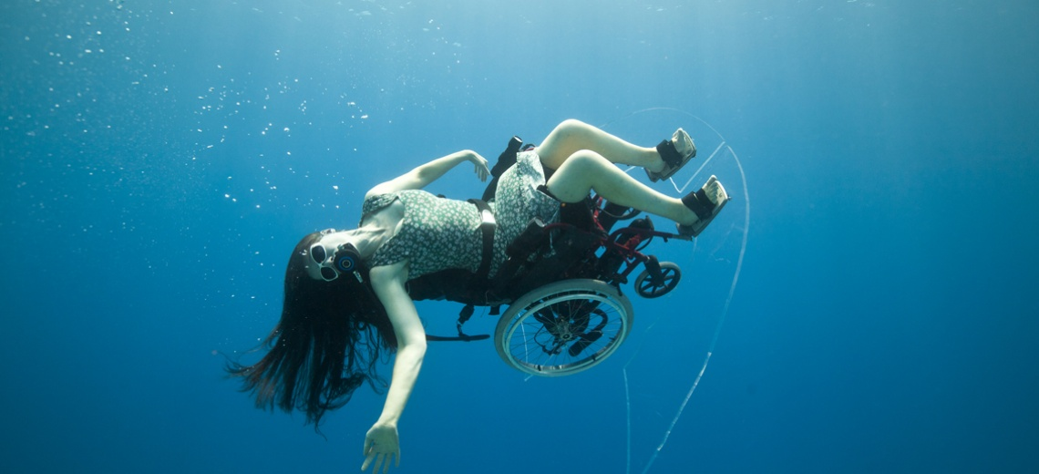 Sue Austin in an underwater wheelchair turned on her side