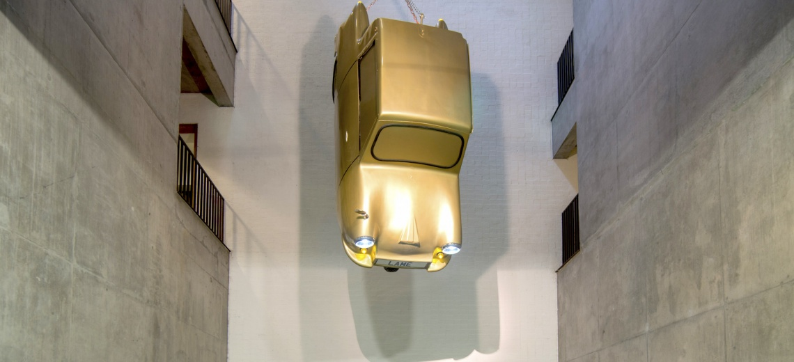 Invacar painted gold suspended from the ceiling