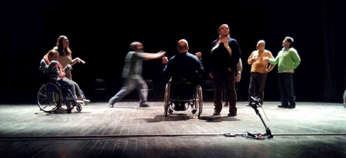 Group of 9 performers moving, including two wheelchair users