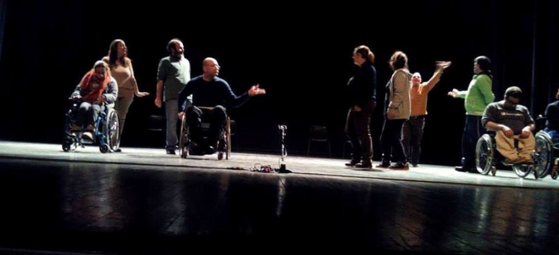 Group of 9 performers moving, including 3 wheelchair users