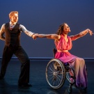 Male and female dance duet, female is a wheelchair users