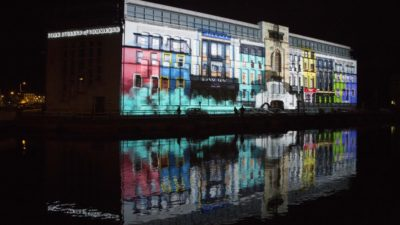 photo of a large building in Cork with a large multimedia projection on the side