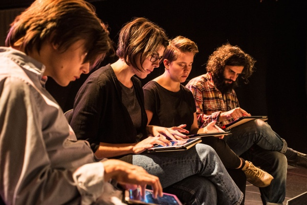 Group of people make music on tablets