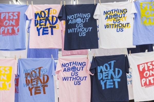 Multiple t-shirts with slogans on