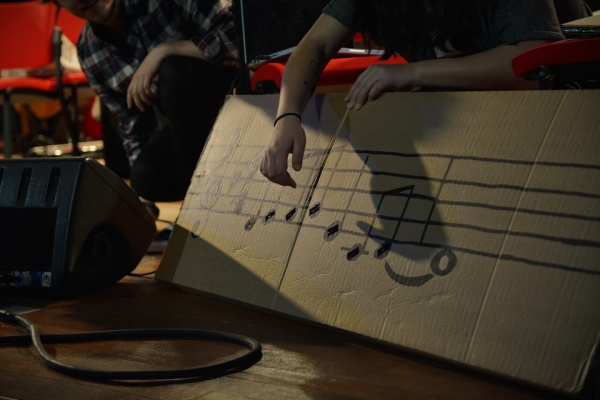A cardboard instrument with a music scale