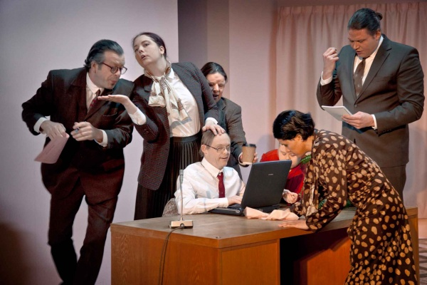 Actors sitting round a desk