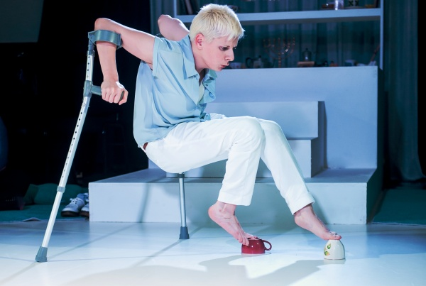Claire Cunningham on crutches balancing on teacups