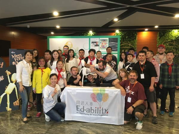 Hijinx facilitators posing with a group of Chinese participants