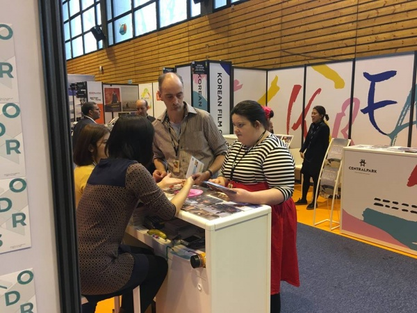 Becky Bruzas and Matthew Hellet at a presentation booth at Clermont Ferrand Film