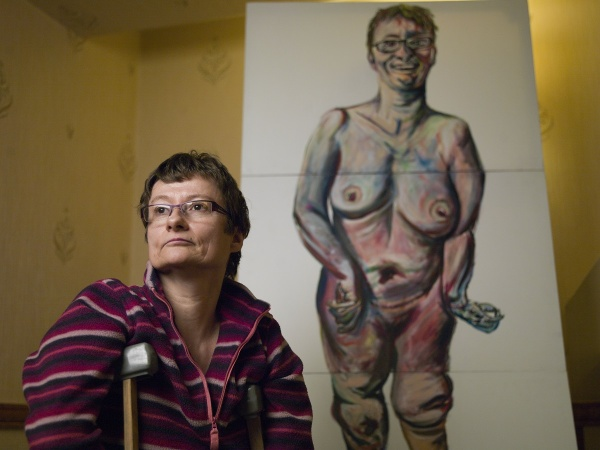 Tanya Raabe Webber standing with her portrait