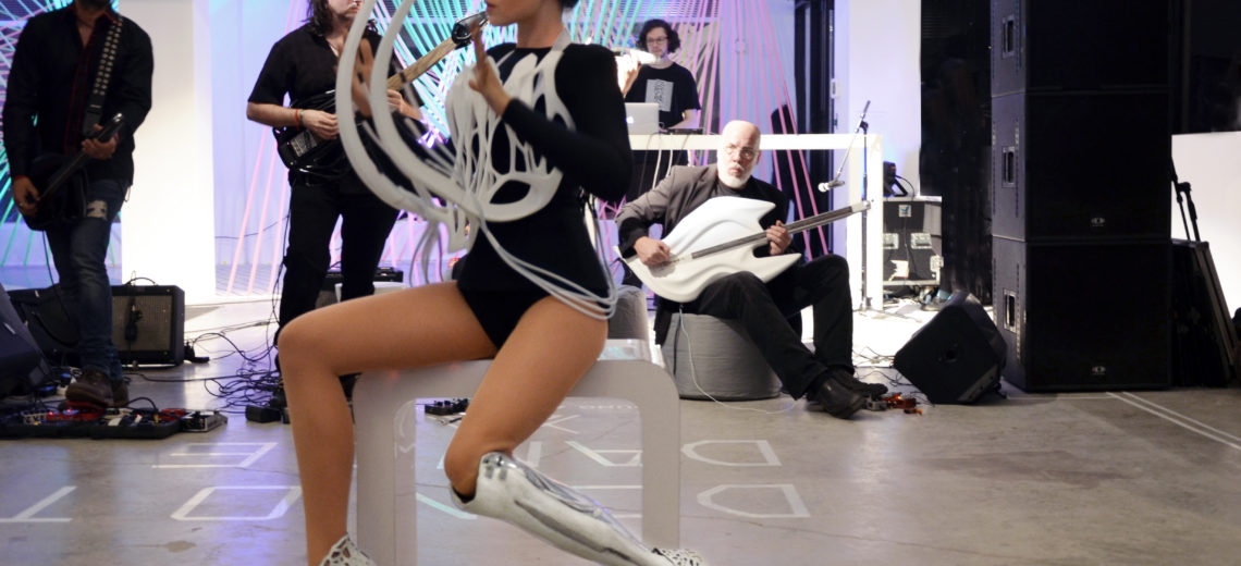 Viktoria Modesta in black leotard with £D-printed costume resembling bones