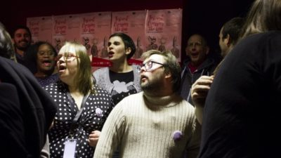 Photograph of a group of people singing