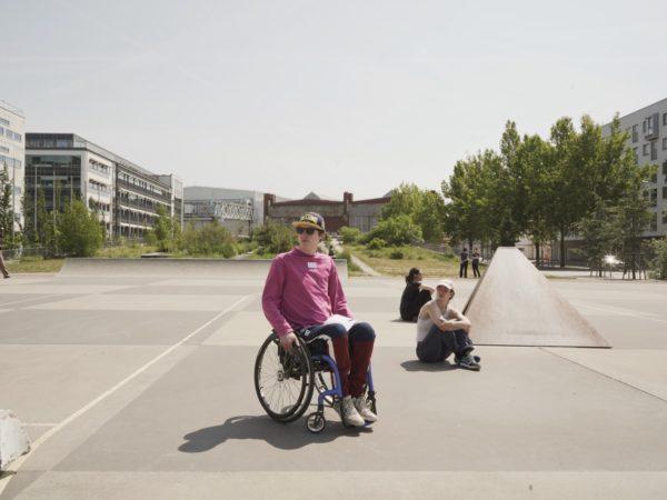 Wheelchair user sitting in a skatepark