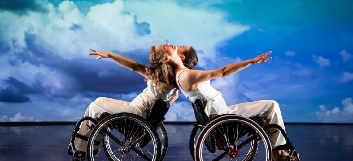 Two female wheelchair dancers on stage