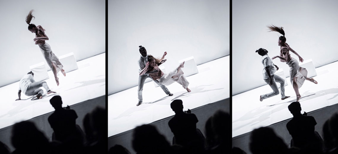Three still images side by side, showing two dancers in three different moments performing on a white spotless stage, in front of the dark silhouettes of the audience.