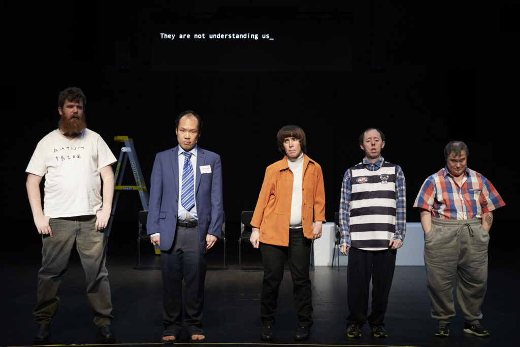 5 disabled performers stand in a line on stage
