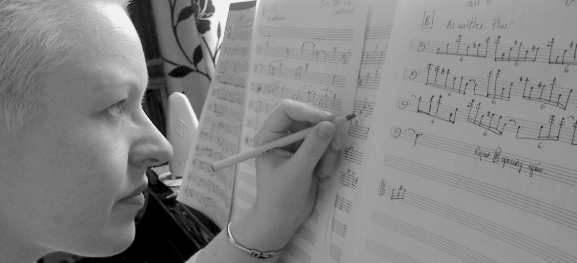 Woman composing at piano