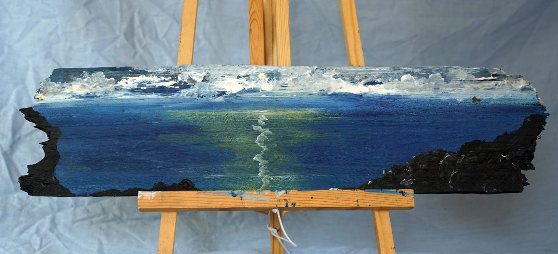 A painting of the sea done on a long piece of driftwood
