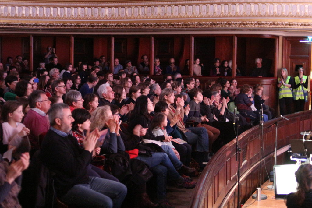 A packed crowd at a opera performance